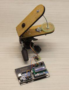 Alex Kuzmuk's laser-cut, Arduino-driven barn door tracker
