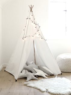 This ethnic-inspired play tent, designed especially for children, is a fantastic way to turn any children's room into a stylish, Scandinavian-inspired playroom. The four wooden poles and stri…