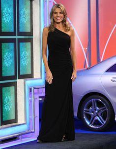 LAUNDRY: Black jersey one-shoulder gown, sleeveless, fabric shirred into black bead motif on left side, skirt slit on left side | Vanna White's dresses | Wheel of Fortune