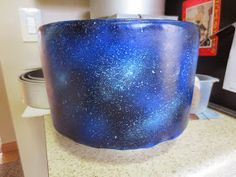 I didn't have an airbrush gun (who does?) so I used Wilton edible spray paint (black, blue, pink, and silver). It came out pretty darn good! -Julia