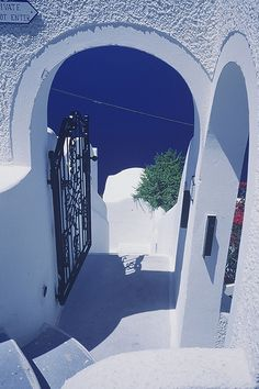 Santorini, Greece  Finding  inspiration to paint doors is easy, they are hundreds of stunning doors here.    behind some    there is an equally stunning view,