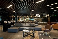 BoConcept Mezzo sofa and Schelly chair in Muse VIP Lounge, Shanghai