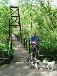 Trail map and photos for an easy an easy, pretty paved trail In Patapsco State Park. This path is wide, shaded, runs along the river, features an historic swinging bridge and has markers explaining the history and features of the area.