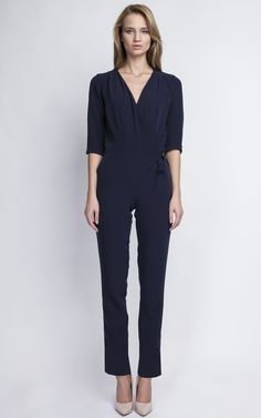 Elegant, blue jumpsuit with a decorative sash at the waist, practical side pockets. Design that will work for both casual and special occasions.