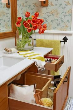Pristine white marble adds unexpected elegance to the pine vanity. A 14-inch-deep drawer under the sink wraps around plumbing to make use of every inch for storage.