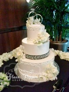 black and white wedding cake with sugar pearls and gems