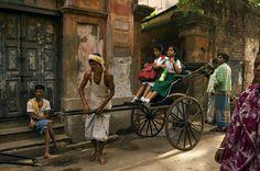 Two girls heading to school via rickshaw in Kolkata - looks like Pratt Memorial School!!