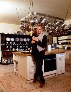 Sting and black cat in a fabulous kitchen! (photo by Geoff Wilkinson/Rex Features)