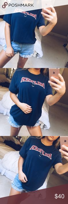"hold •• navy & red tommy tee super cute navy blue and red tommy hilfiger tee! super comfy and cute paired with some denim! red text that says ""hilfiger"" in velvet lettering 🥀 size medium, in perfect condition 🌿 Tommy Hilfiger Tops Tees - Short Sleeve"