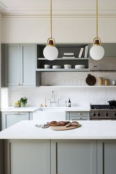 Scandinavian kitchen style is well-known for its simple appearance. the vibe of your kitchen, buying a contemporary table as furniture would Green Kitchen Cabinets, Kitchen Cabinet Design, Kitchen Cabinetry, Kitchen Interior, New Kitchen, Kitchen Decor, Scandinavian Kitchen Cabinets, Kitchen Ideas, Kitchen Storage