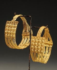 ETRUSCAN GOLD FILIGREE EARRINGS. Probably from Vetulonia. 7th Century BC. Ex Thane Collection, England.