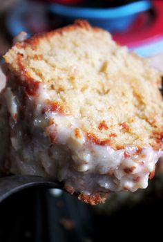 It's TWO favorite Southern desserts, Louisiana Crunch Cake and Kentucky Butter Cake, made into ONE mouthwatering creation that'll make your knees buckle! An intensely rich and moist buttermilk cake soaked in a sweet, buttery cream cheese glaze with an almond nutty crunch…and did we mention the toasted coconut? Oh my Lord!