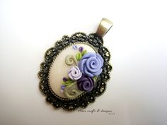 purple polymer clay roses in an antiqued brass setting