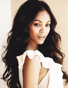 Zoe Saldana as Rhiannon, one of the Desert Peoples born in captivity. Zerlina's personal slave and ally to the Aleerians in Moldov