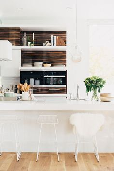 white kitchen, wood, white stools