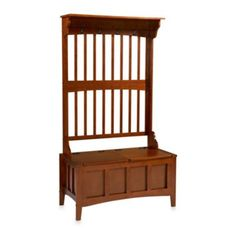 Linon Home Hall Tree with Storage Bench - BedBathandBeyond.com Keep your entryway neat and tidy with the unique Linon Home Hall Tree with Storage Bench. With four coat hooks and a spacious seating area that flips up to reveal a large storage section, the walnut bench is the perfect addition to any room.