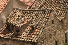 Old red tile rooftops in Dubrovnik are uneven and show interesting character These roofs show some p Stock Photo