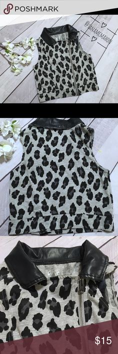 Justice Vest Adorable animal print vest Brand: Justice Size 10 in girls  Never worn so it's in like new condition  New without tags Black & Gray colors Chic leather collar Justice Jackets & Coats Vests