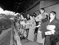 "The change of season, or ""Setsubun,"" is celebrated in traditional fashion at the Asakusa Temple in Tokyo on Feb. 9, 1950 as a geisha girl, a sumo wrestler and other prominent personalities throw out roasted beans to the crowd that has gathered. As the beans are scattered, the person who tosses chants or sings: ""Devil outside, good luck inside."" Custom is part of the temple festivities and Merry-making which greet the change of season, which comes on February 3 in Japan."