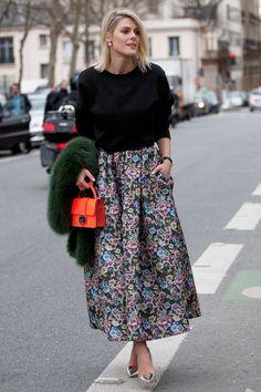 Street Style - floral skirt - black jumper - green jacket - orange clutch - silver heels @ Paris Fashion Week 2014
