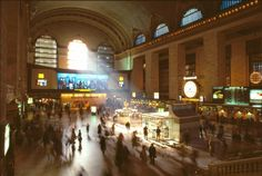 A view of the main concourse in 1985 with the Kodak Colorama on the East Balcony, the Merrill Lynch booth on the floor, the Newsweek clock between the columns on the south side and the Chemical Bank branch where the new east stairs now rise. Grand Central will mark its 100th anniversary this week. Photo: Contributed Photo