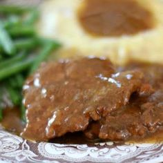 Crock Pot Cubed Steak with Gravy is the ultimate no-fuss weeknight dinner recipe. Tender, flavorful and goes perfect with some mashed potatoes!
