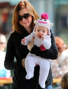 Alum: Alyson Hannigan and hubby Alexis Denisof with their daughters Satyana, 3 and 6 month old Keeva shopping at the Malibu Country Mart, California