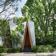 Sayama+Forest+Chapel+by+Hiroshi+Nakamura+is+covered+with+hand-bent+aluminium+shingles