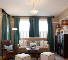turquoise drapes enliven the neutral monotony