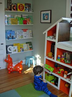 book display wall and the barn toy shelf...so cute!