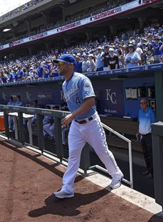 Kansas City Royals left fielder Alex Gordon (4) walked onto the field to join teammates to receive their 2015 All-Star jerseys prior to Saturday's baseball game against the Toronto Blue Jays on July 11, 2015 at Kauffman Stadium in Kansas City, Mo.