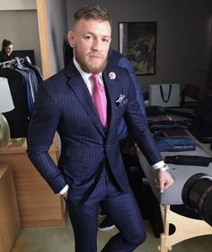 """Conor McGregor Wears David August Collab """"F*ck You"""" Pinstripe Suit for Mayweather vs McGregor World Tour 
