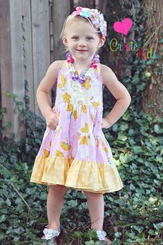 Re-release from Create Kids Couture! Lola's Tiered Twirly Dress PDF pattern now includes sizes 6 months-8. A beautiful tiered halter dress. See how to add the perfect bow on our blog! http://createkidscouture.blogspot.com/2013/05/tutorial-tuesday-perfect-bow.html