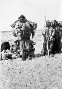 Inuit group breaking camp - 1919 styling and accessories - backpack