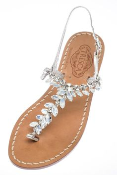 """With her versatile milky and clear stones and silver Italian leather straps, you will have a hard time not wearing her everyday!Our soles are European sizes made in Italy. They are made from Italian leather with a wrapped, wooden heel. Please consult the size guide. If you're a half size, size up. All of our Italian sandals are handmade to order by our cobbler in store. We keep true to the Capri sandal by using nails not glue. We offer a 1/2"""" flat as well as a 1"""" heel.Because each is…"""