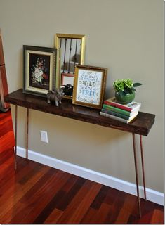 DIY Console Table that I really like! Especially the copper legs.
