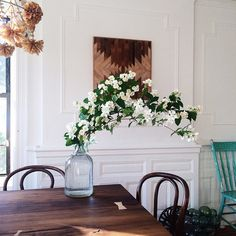Instagram Stories: Ariele Alasko. A blooming philadelphus branch adds softeness in Alasko's dining room.