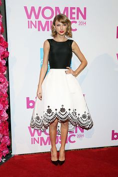 In Oscar de la Renta at the 2014 Billboard Women in Music Luncheon in New York. See Taylor Swift's full fashion evolution, from sequins in 2007 to her many crop tops today.