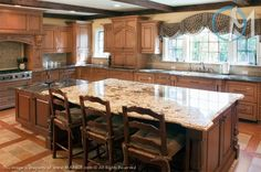 The light versus dark granite set-up on the island adds an interesting twist for this spacious kitchen.