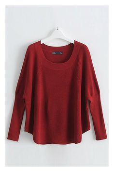 Knit Jumper, featuring a cape style design, ribbed round neckline, bat long sleeves with ribbed cuffs, asymmetric curve hem.$45