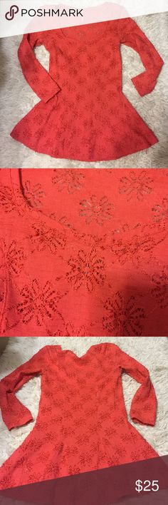 Free People Coral Peplum Lace Blouse Form fitting. Nylon/spandex. Looks more orange in the photos but it is coral colored. Free People Tops Blouses