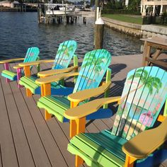 I love adirondack chairs....although this paint job is hideous, they must must have extra wide arm rests and the curved back like these.