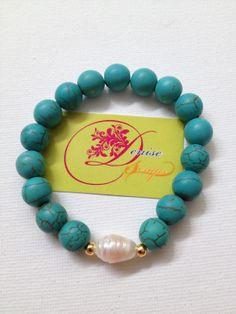 photo (132) pulsera en bolitas azules y una blanca perlada.  By Denise Scraps