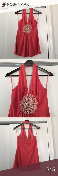 Pretty pink halter top with crochet appliqué Pretty pink colored summer halter top with V neck. Cute crochet circle detailing in front. Size S and gently worn. swaui Tops Tank Tops