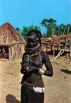 "Angola ""Africa Portuguesa: Mulia girl with ornaments. Dated July Publisher Comer, Lisabon Tribal People, Tribal Women, African Tribes, African Women, African Beauty, African Fashion, Xingu, Foto Art, African Culture"