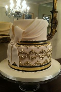 Gold wedding cake  www.tablescapesbydesign.com https://www.facebook.com/pages/Tablescapes-By-Design/129811416695