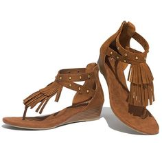 """Pocahontas would turn green with envy! Cushion Walk® sandals that have two layers of fringe detail on the vamp to the toe-strap and two ankle straps with gold rivets. Features padded arch and heel seat, flexible sole and back zipper for easy on/off.  · Whole sizes: 6M - 11M. Half sizes, order one size down.  · Heel: 1 1/2"""" H  · Sock lining: cognac faux suede  · Outsole: TPR (Thermal Plastic Rubber).  · Wipe with a dry cloth"""