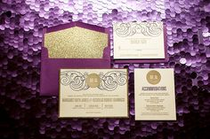 This glittery purple & gold letterpress wedding invitation suite features an elegant swirl pattern with a circle monogram. It is letterpress