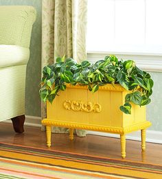 New Planter - Create a stunning planter box using spare trim pieces. Start with a rough redwood planter and sand lightly. Glue on trim, prime and paint, and then install legs.
