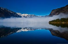 Morning reflecion at the Lake Bohinj - Lake Bohinj, covering 318 hectares (790 acres), is the largest permanent lake in Slovenia. It is located within the Bohinj Valley of the Julian Alps